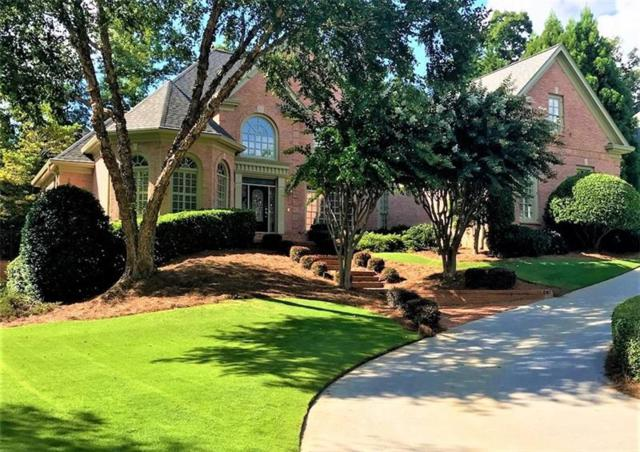 6045 Laurel Oak Drive, Suwanee, GA 30024 (MLS #6057213) :: North Atlanta Home Team
