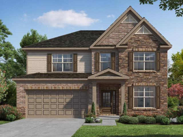 411 Honeybee Lane, Holly Springs, GA 30115 (MLS #6058786) :: The Russell Group