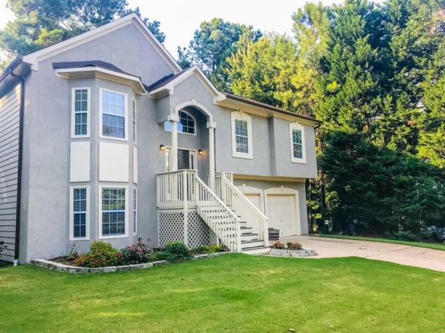 7044 Surrey Drive, Woodstock, GA 30189 (MLS #6058995) :: Path & Post Real Estate