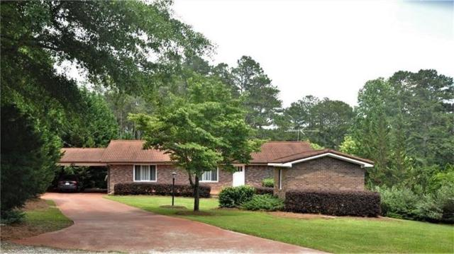 7070 Cagle Drive, Cumming, GA 30041 (MLS #6071577) :: The Russell Group
