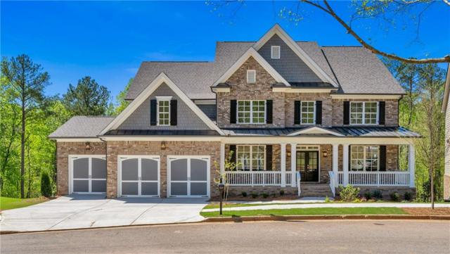 225 Harmony Lake Drive, Holly Springs, GA 30115 (MLS #6555003) :: Rock River Realty
