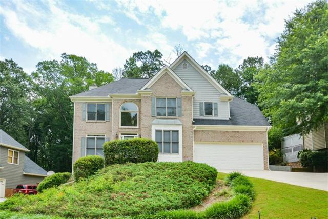 8032 Ridge Valley, Woodstock, GA 30189 (MLS #6567880) :: Rock River Realty