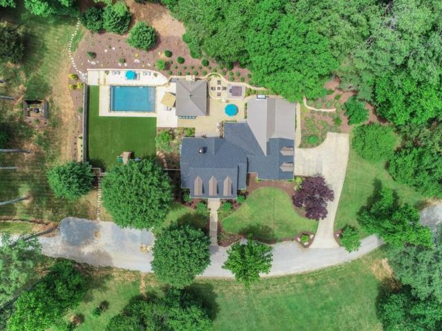 15535 Wood Road, Milton, GA 30004 (MLS #6575464) :: North Atlanta Home Team