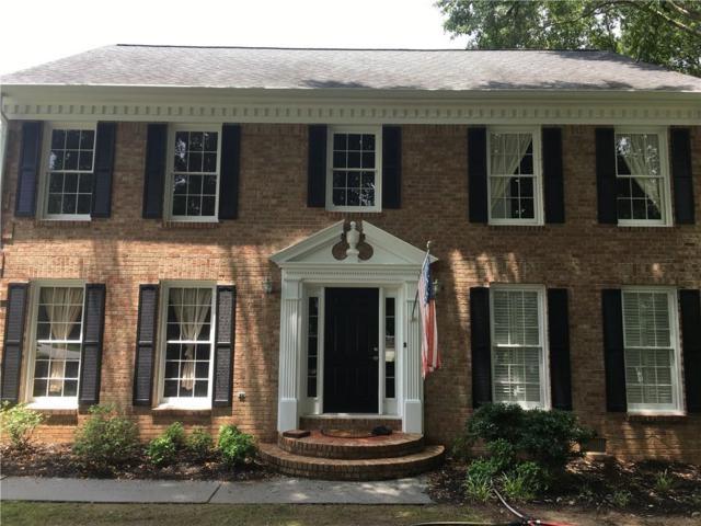 4877 Castlewood Drive SW, Lilburn, GA 30047 (MLS #6576833) :: RE/MAX Paramount Properties