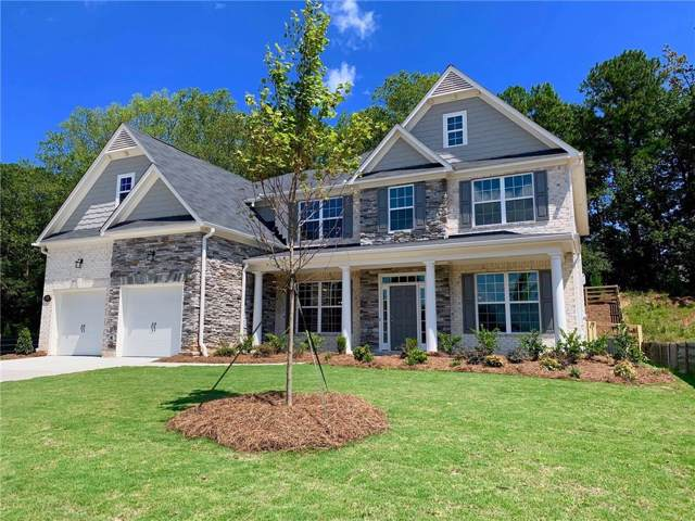 216 Wild Rose Circle, Holly Springs, GA 30115 (MLS #6612393) :: The Realty Queen Team