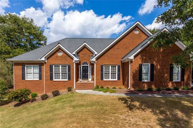 1215 Maple Creek Ln, Loganville, GA 30052 (MLS #6621015) :: Charlie Ballard Real Estate