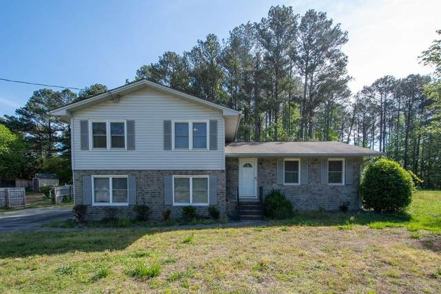 1182 Holly Hills Drive SW, Lilburn, GA 30047 (MLS #6711620) :: Thomas Ramon Realty