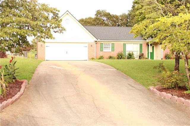 3874 SW Hunters Chase SW, Conyers, GA 30094 (MLS #6782653) :: The Heyl Group at Keller Williams