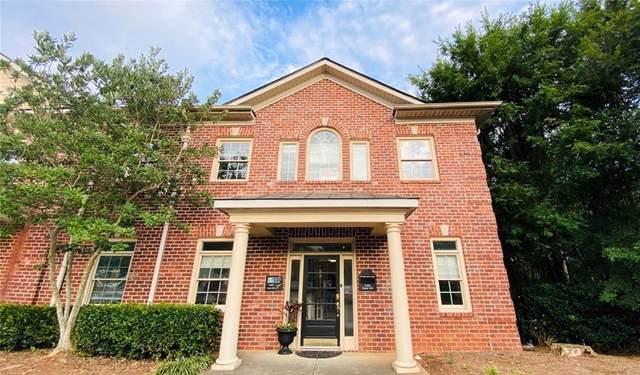 5460 Mcginnis Village Place #104, Alpharetta, GA 30005 (MLS #6876776) :: Dillard and Company Realty Group