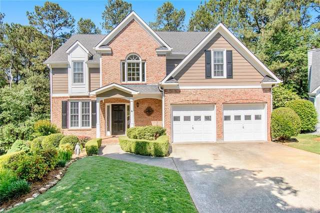 127 Dragging Canoe, Woodstock, GA 30189 (MLS #6883918) :: The Heyl Group at Keller Williams
