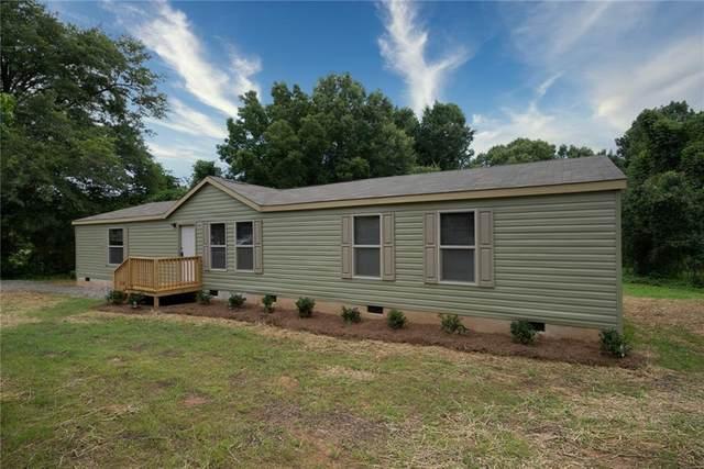 1040 River Woods Drive, Madison, GA 30650 (MLS #6912194) :: RE/MAX Paramount Properties