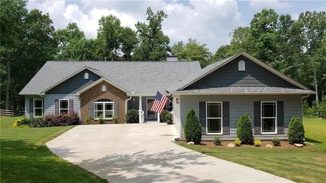 101 Sharp Mountain Creek, Ball Ground, GA 30107 (MLS #6928187) :: North Atlanta Home Team