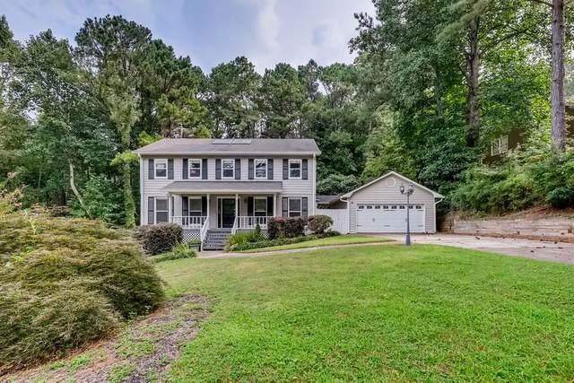 3880 W Cooper Lake Drive SE, Smyrna, GA 30082 (MLS #6939577) :: North Atlanta Home Team