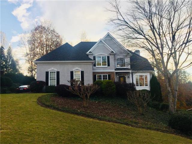 5038 Winding Hills Lane, Woodstock, GA 30189 (MLS #5915758) :: Path & Post Real Estate
