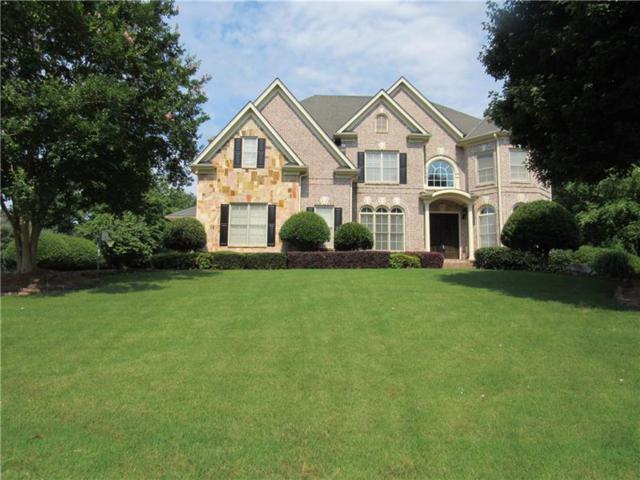12760 Oak Falls Drive, Alpharetta, GA 30009 (MLS #5963017) :: North Atlanta Home Team