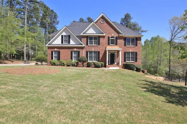 1004 Creek Side Drive, Canton, GA 30115 (MLS #5978090) :: North Atlanta Home Team