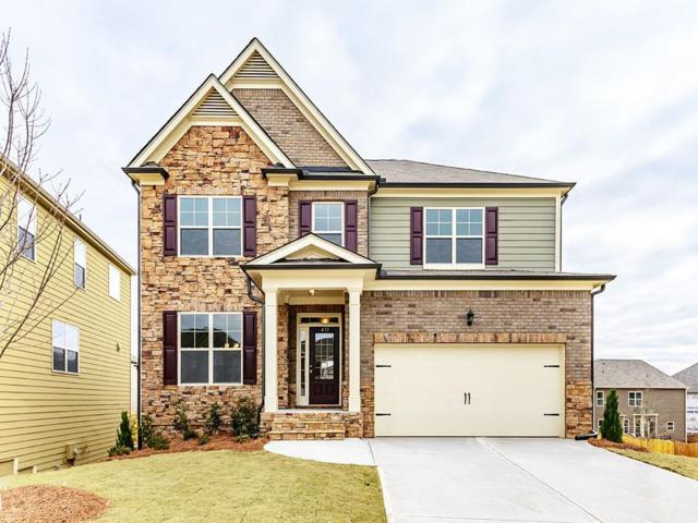 411 Honeybee Lane, Holly Springs, GA 30115 (MLS #6058786) :: The Cowan Connection Team