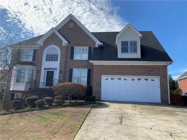 1375 Country Lake Drive SW, Lilburn, GA 30047 (MLS #6661124) :: North Atlanta Home Team