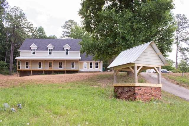 10653 Hickory Flat Highway, Woodstock, GA 30188 (MLS #6719120) :: North Atlanta Home Team