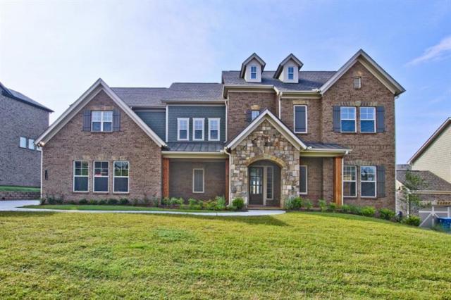 6120 Woodlawn Drive, Suwanee, GA 30024 (MLS #5901414) :: North Atlanta Home Team