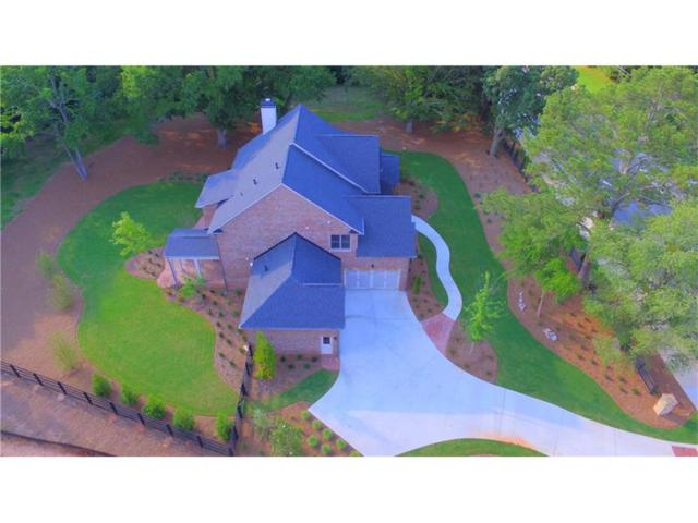 10760 Rogers Circle, Johns Creek, GA 30097 (MLS #5858726) :: North Atlanta Home Team