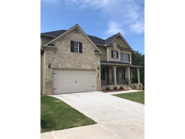 325 Hillgrove Drive, Holly Springs, GA 30114 (MLS #5750079) :: North Atlanta Home Team