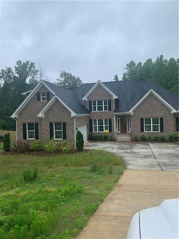 515 Riverside Road, Sugar Hill, GA 30518 (MLS #6729399) :: Dillard and Company Realty Group