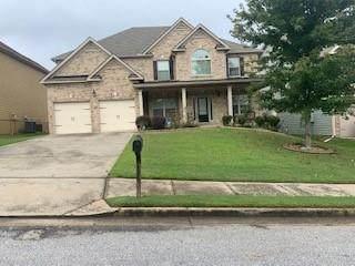 4059 Dinmont Chase, Atlanta, GA 30349 (MLS #6947643) :: The Justin Landis Group