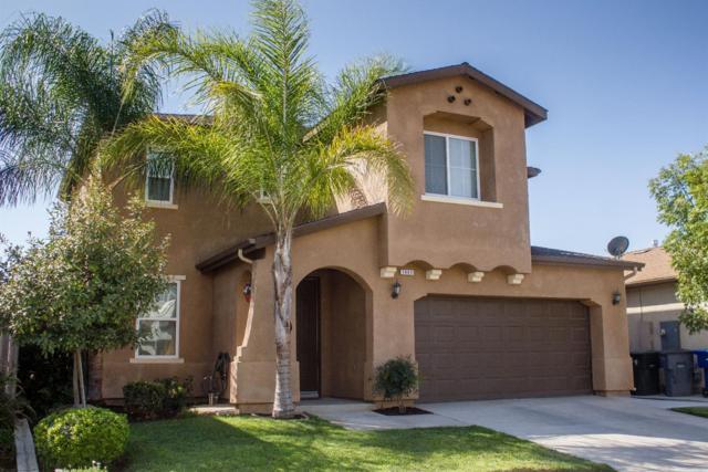 7441 E Robinson Avenue, Fresno, CA 93737 (#489876) :: Raymer Team Real Estate
