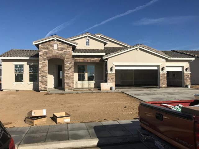 772 E Aretha Avenue, Fowler, CA 93625 (#494249) :: FresYes Realty