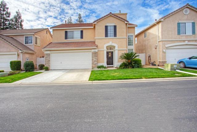 7530 N Trellis Circle, Fresno, CA 93720 (#497410) :: FresYes Realty