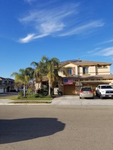 7036 E Robinson Avenue, Fresno, CA 93737 (#497456) :: Soledad Hernandez Group