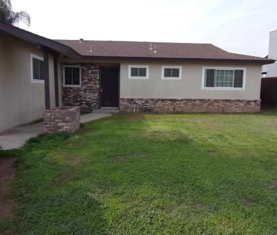4105 N Gilroy Avenue, Fresno, CA 93722 (#497461) :: FresYes Realty