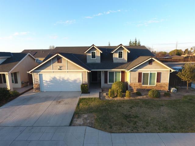 5042 W Harvard Avenue, Fresno, CA 93722 (#497488) :: FresYes Realty