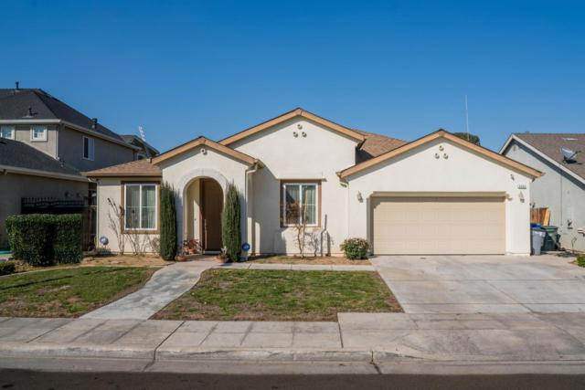 5332 W Cotton Avenue, Fresno, CA 93722 (#497518) :: FresYes Realty