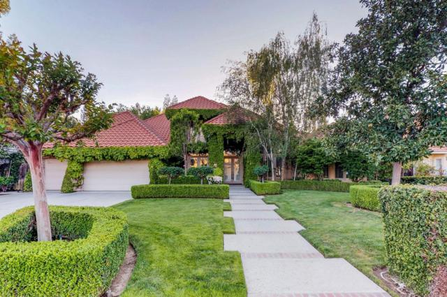 10407 N Spring Hills Drive, Fresno, CA 93730 (#501208) :: FresYes Realty