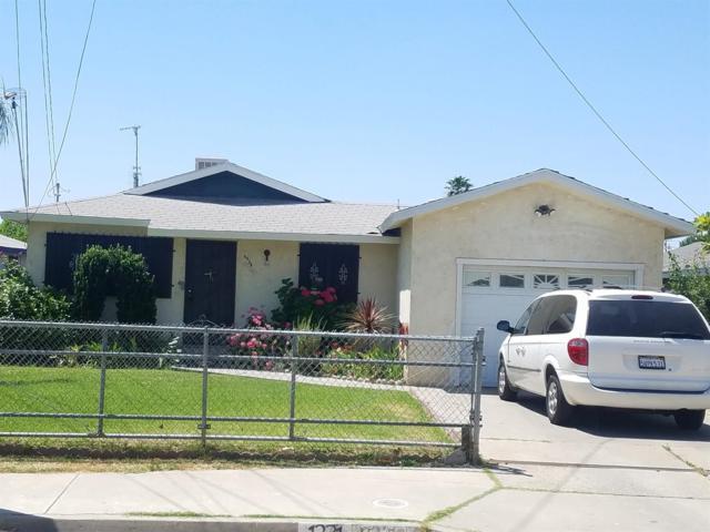 1231 J Street, Orange Cove, CA 93646 (#504217) :: FresYes Realty