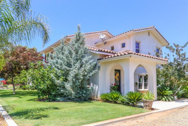 7606 E Muscat Avenue, Fresno, CA 93725 (#505779) :: FresYes Realty