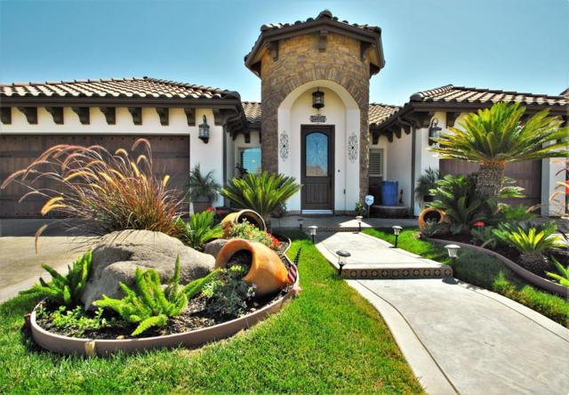 6815 W Wrenwood Lane, Fresno, CA 93723 (#506112) :: FresYes Realty