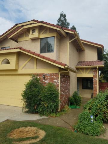 461 E Alluvial Avenue #102, Fresno, CA 93720 (#506448) :: FresYes Realty