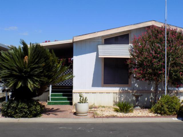 3138 W Dakota Avenue #209, Fresno, CA 93722 (#506454) :: FresYes Realty