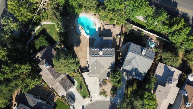9980 N Canyon Creek Lane, Fresno, CA 93730 (#506518) :: FresYes Realty