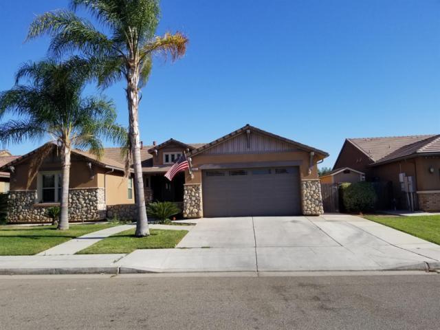 5949 W Ashcroft Avenue, Fresno, CA 93722 (#506560) :: FresYes Realty