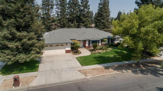 7694 N Mansionette Drive, Fresno, CA 93720 (#506696) :: FresYes Realty