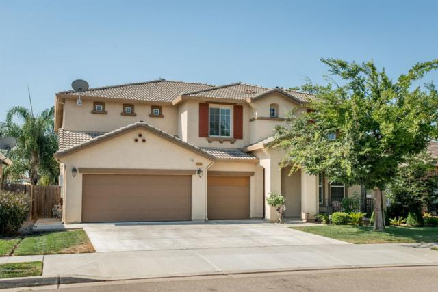 7055 E Garland Avenue, Fresno, CA 93737 (#507635) :: Soledad Hernandez Group