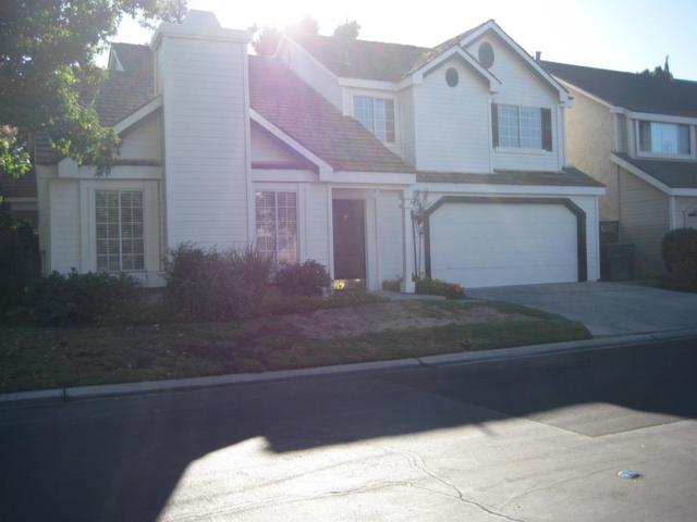 10709 N Windham Bay Circle, Fresno, CA 93730 (#509779) :: FresYes Realty