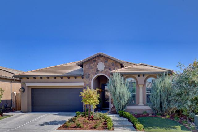 1848 E Bella Rosa Avenue, Fresno, CA 93730 (#510471) :: Soledad Hernandez Group