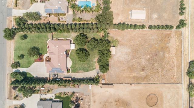 6912 N Leonard Avenue, Clovis, CA 93619 (#512233) :: FresYes Realty