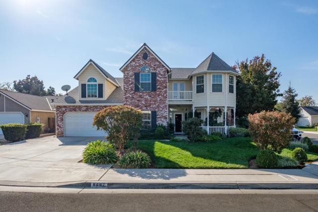 6682 N Delbert Avenue, Fresno, CA 93722 (#512963) :: Raymer Realty Group