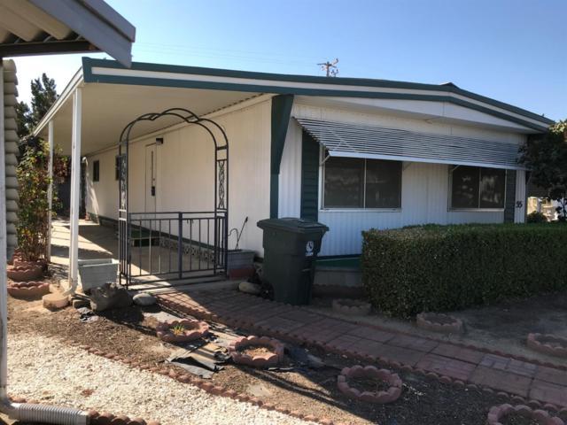 1300 W Olson Avenue #55, Reedley, CA 93654 (#513129) :: FresYes Realty